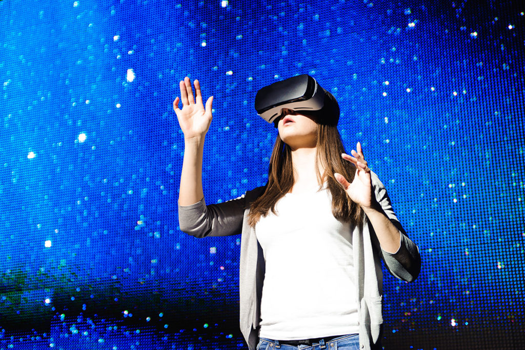 virtual reality travel trends 2018 girl looking at vr goggles